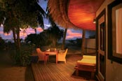 Angsana Velavaru Resort beach front villa at sunset
