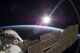 Picture of the Sun and the Earth from ISS