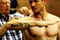 Felix Baumgartner showing his tattoo - born to fly