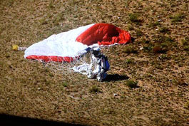 Felix Baumgartner lands after breaking many records skydiving