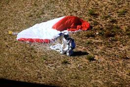 Felix Baumgartner lands after breaking many records skydiving