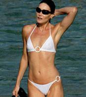 Carla Bruni in tiny see through white bikini