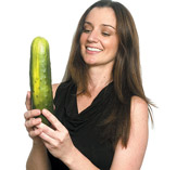 A girl with cucumber according all EU standards