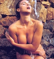 Monica Bellucci under waterfall