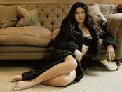 Monica Bellucci posing on the floor
