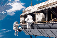 Astronauts working on International Space Station