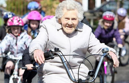 grandmother riding bicycle