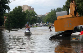 Men riding scooter and jet ski in the city